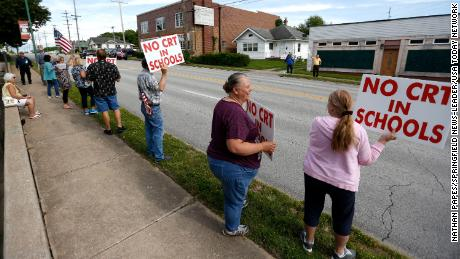 Demonstrators protest critical race theory being taught in Springfield, Missouri, schools on Tuesday, May 18, 2021.