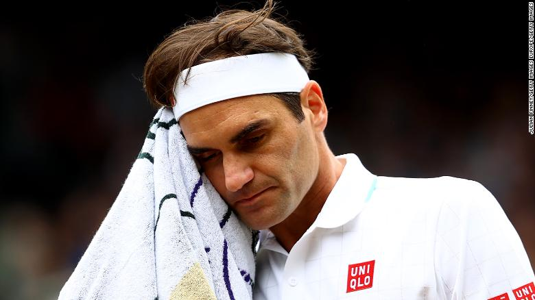 LONDON, ENGLAND - JULY 07: Roger Federer of Switzerland towels off during his men's Singles Quarter Final match against Hubert Hurkacz of Poland on Day Nine of The Championships - Wimbledon 2021 at All England Lawn Tennis and Croquet Club on July 07, 2021 in London, England. (Photo by Julian Finney/Getty Images)