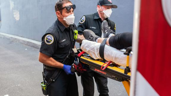 Paramedics Cody Miller, left, and Justin Jones respond to a heat exposure call during a heat wave, Saturday, June 26, 2021, in Salem, Ore. (AP Photo/Nathan Howard)