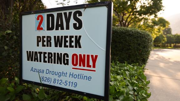 A sign is posted about watering limits in Azusa, California, on June 29.