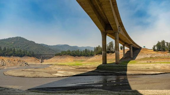 As the Salt Fire burns nearby, a section of the drought-stricken Shasta Lake sits mostly dry in Lakehead, California, on July 2. Firefighters were battling nearly a dozen wildfires in the region.