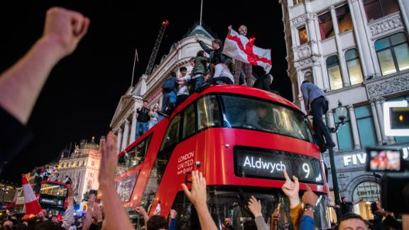 Euphoric England football fans celebrate in the streets of central London after the country reached the finals.