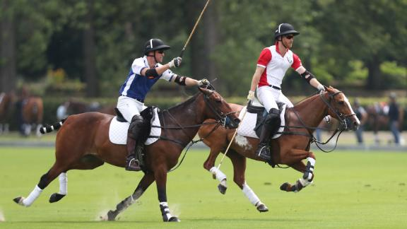 William and Harry compete in a charity polo event in 2019.