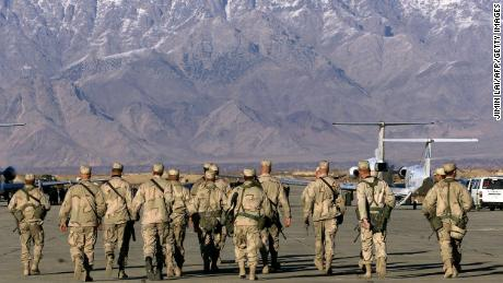 In this file photo taken on January 15, 2002, American service members approach United Nations planes on the tarmac of Bagram air base.