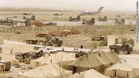 US military aircraft populate the runways of Bagram air base while tents are set up in the foreground on April 4, 2002.