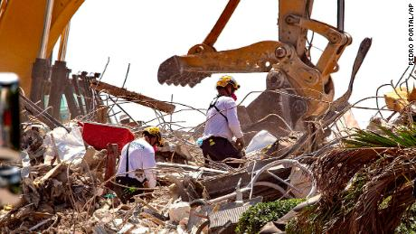 Rescue teams from Pennsylvania search the rubble of the South Champlain Towers on July 8.