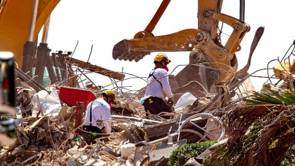 Rescue teams from Pennsylvania search the rubble of the Champlain Towers South on July 8.