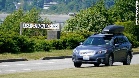 Canada will not open its border to non-essential, unvaccinated visitors for quite a while, Trudeau says