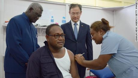 The Solomon Islands Deputy Prime Minister Manasseh Maelanga receives a vaccine provided by China on May 21, 2021.