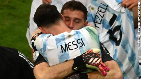 Argentina's goalkeeper Emiliano Martinez and Argentina's Lionel Messi embraces Emiliano Martinez after the goalkeeper's shootout heroics.