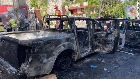 Burned-out cars can be seen where the police engaged in a gun battle with the suspected assassins near Haiti's national palace on Route de Kenschoff.