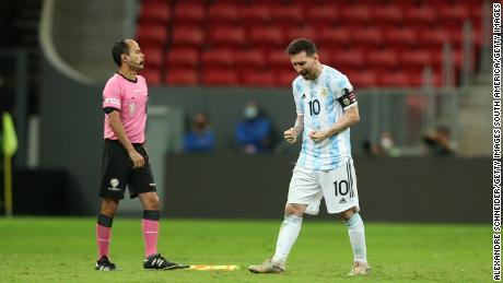 Messi celebrates after scoring his penalty during the shootout against Colombia.