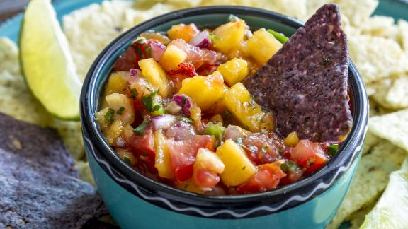 Spice up your summer cookouts with peach salsa.