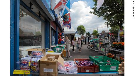 A girl peruses an array of marching season paraphernalia on the Shankill Road in west Belfast.