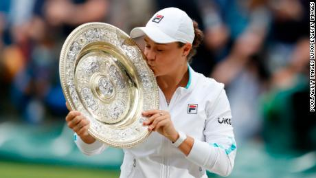 Ashleigh Barty kisses the Venus Rosewater Dish trophy after winning her first Wimbledon single's title.
