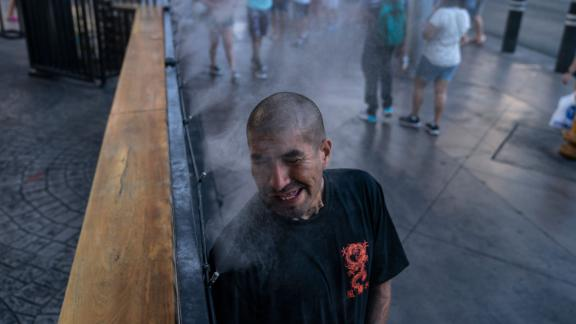 Golden Davis cools off in a mister along the Las Vegas Strip on July 9. The city tied its all-time temperature record of 117 degrees Fahrenheit over the weekend.