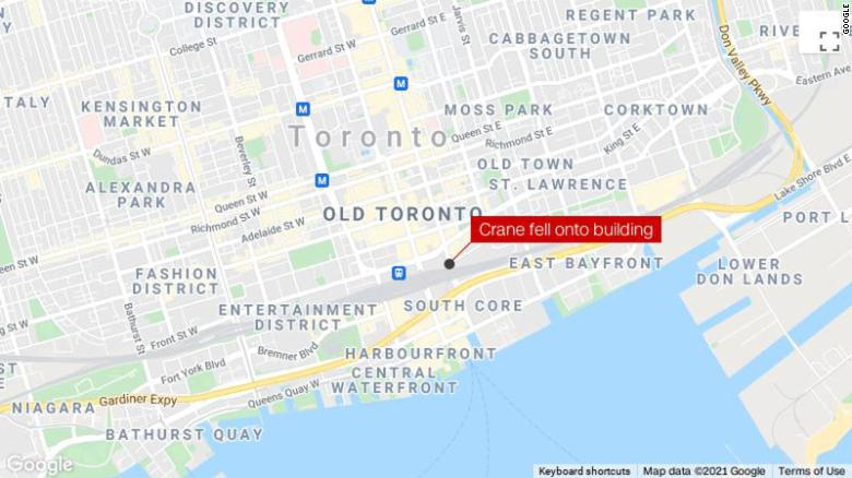 A crane fell on top of a building in downtown Toronto, causing damage