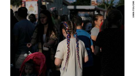 A young loyalist sporting red, white, and blue braids  -- the colors of the Union Flag -- attends a parade on the Shankill Road in west Belfast.