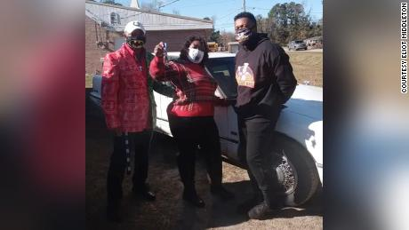 Middleton, right, with Melanie Lee, middle, and her nephew Frank McClary, the mayor of Andrews, South Carolina, after Middleton surprised Lee with a car.