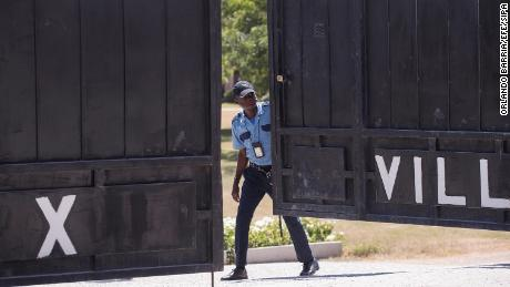 Guards guard the morgue where the body of President Jovenel Moise was being held on Saturday.