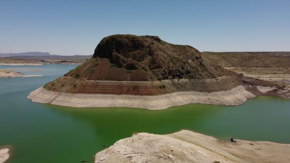Water-level lines, unveiled by years of drought, are seen on the rocks of the Elephant Butte Reservoir in Truth or Consequences, New Mexico, on July 9.
