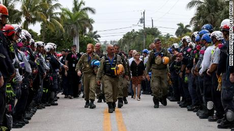 Members of the Israel Defense Forces' (IDF) National Rescue Unit are given a send-off by search and rescue personnel on July 10 in Surfside, Florida.