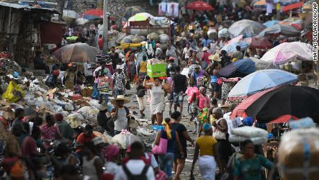 A woman carries her belongings at the Petion-Ville market in Port-au-Prince, Haiti, on July 11, four days after the assassination of President Jovenel Moise.
