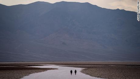 People walk on salt flats in Badwater Basin, Sunday.