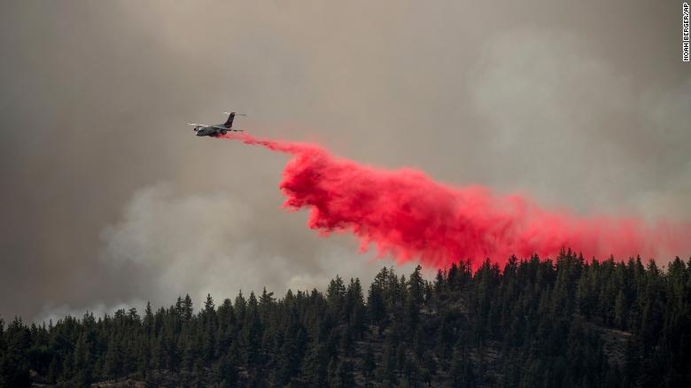 An air tanker drops retardant to keep the Sugar Fire, part of the Beckwourth Complex Fire, from reaching the Beckwourth community of unincorporated Plumas County, California, on Friday, July 9, 2021.
