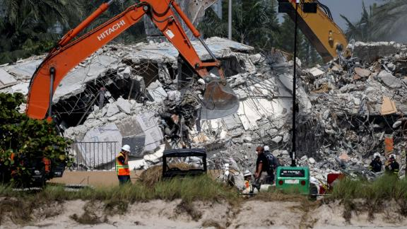 Excavators dig through the remains from the Champlain Towers South building on July 9.