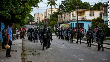 Riot police walk the streets after a demonstration against the government of Cuban President Miguel Diaz-Canel in Arroyo Naranjo Municipality, Havana on July 12.