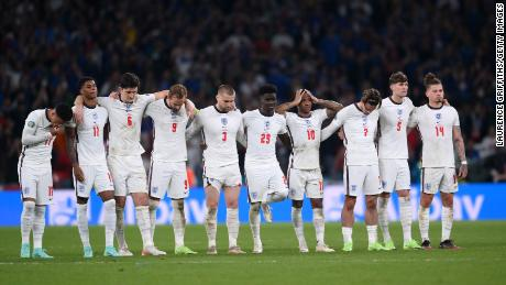 England players, including Rashford, look on during the penalty shoot out against Italy.