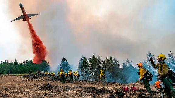 A plane drops fire retardant on Harlow Ridge above the Lick Creek Fire, southwest of Asotin, Washington, on July 12. The fire started the week before and has burned more than 50,000 acres of land between Asotin County and Garfield County.