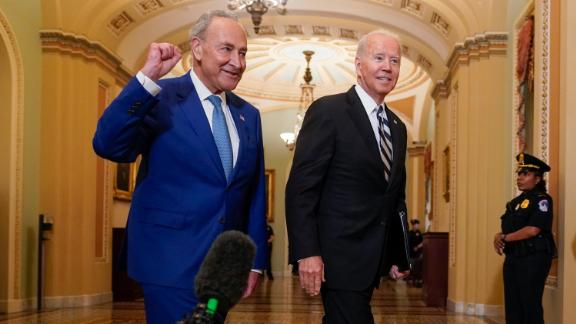 President Joe Biden walks with Senate Majority Leader Chuck Schumer, D-N.Y., at the Capitol in Washington, Wednesday, July 14, 2021, as he arrives to discuss the latest progress on his infrastructure agenda.