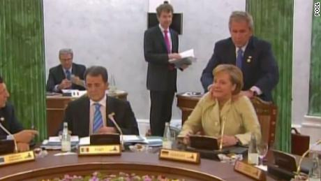 The neck rub that reverberated around the world. Bush eases tensions in Germany in July 2006.