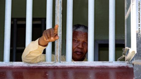 Nelson Mandela stares out of the window of the prison cell he occupied on Robben Island for much of his 27 year prison sentence. It was at Robben that Mandela learned the language and ways of his White jailers.