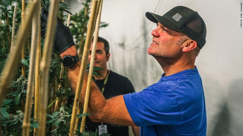 Dale Katechis, whose eponymous and top-selling Dale's Pale Ale revolutionized canned beers, has invested in and taken an active leadership role at Veritas Fine Cannabis, a boutique wholesaler specializing in cultivating and selling premium cannabis. Katechis (foreground) is pictured with Veritas CEO Mike Leibowitz.