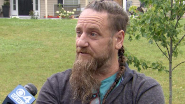 A car slammed into a home injuring a young girl, so a stranger jumped to action and saved her
