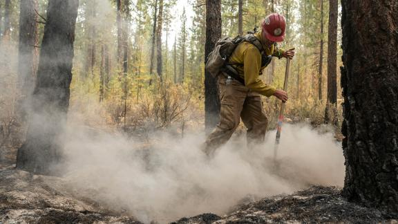 Firefighter Garrett Suza, with the Chiloquin Forest Service, mops up a hot spot on the North East side of the Bootleg Fire on Wednesday.