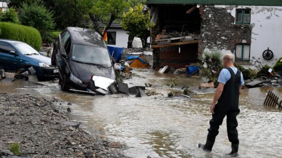 A resident of North-Rhine Westphalia examines the damage on Thursday.