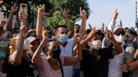 Anti-government protesters march in Havana on Sunday.