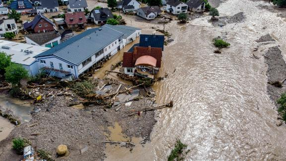 Houses are damaged by flooding in Insul, Germany, on Thursday.