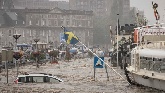 A car floats in the Meuse River during heavy flooding in Liege, Belgium, on Thursday.