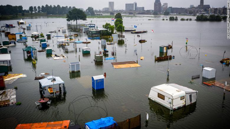 Caravans and campers are partially submerged in Roermond, Netherlands.