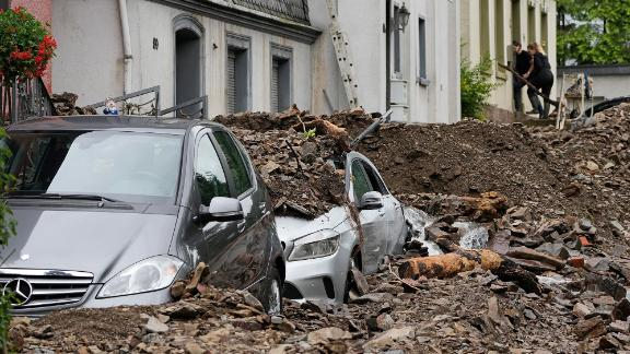 Cars are covered by debris in Hagen, Germany.