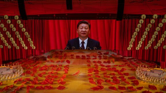 Chinese President Xi Jinping appears on a large screen during a dance performance at a mass gala marking the 100th anniversary of the Communist Party in Beijing.