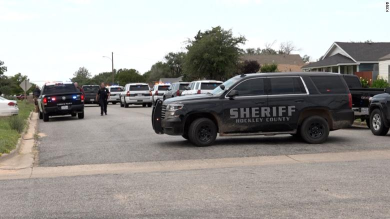 An officer is killed and 3 others wounded during a standoff in a Texas town