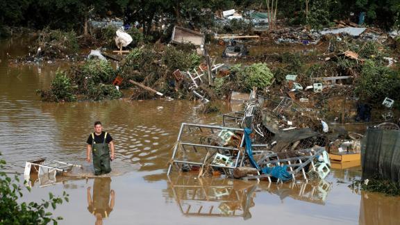 A man walks through a flooded part of Bad Neuenahr-Ahrweiler, Germany, on Thursday.