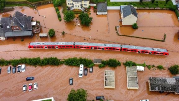 A regional train sits in floodwaters at the local station in Kordel, Germany.
