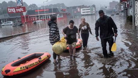 Residents use rubber rafts to evacuate after the Meuse River broke its banks during heavy flooding in Liege, Belgium, on Thursday.